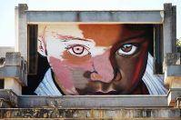 Rutigliano, sul Mercato Coperto spunta il volto del bimbo deturpato a Bari