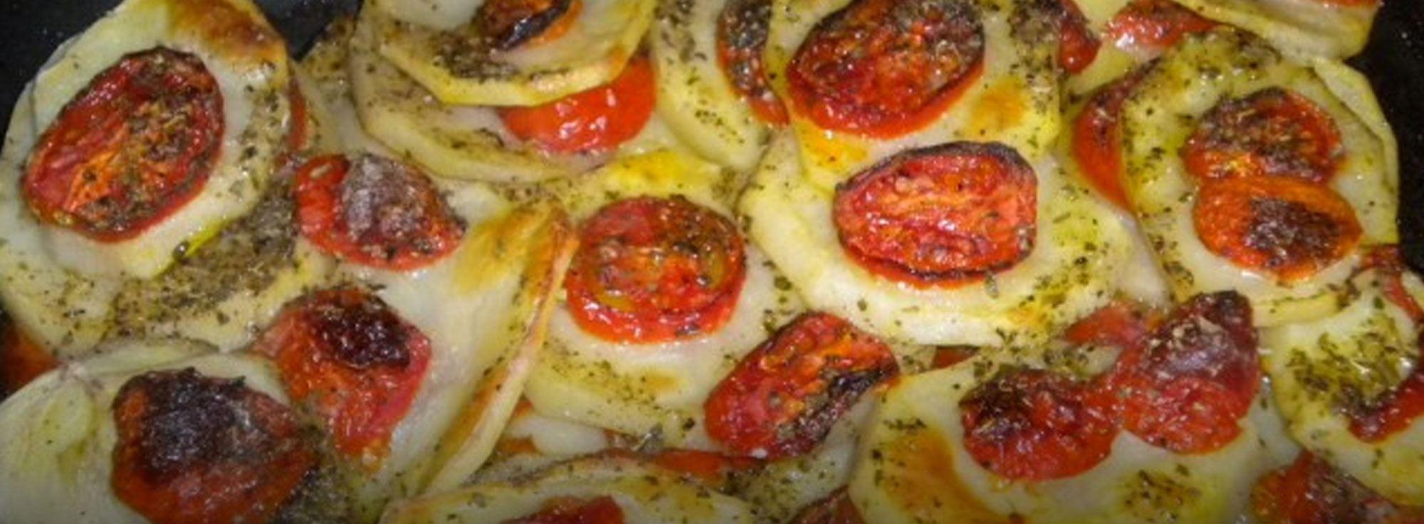 Ricetta: Teglia di patate e pomodori agli aromi