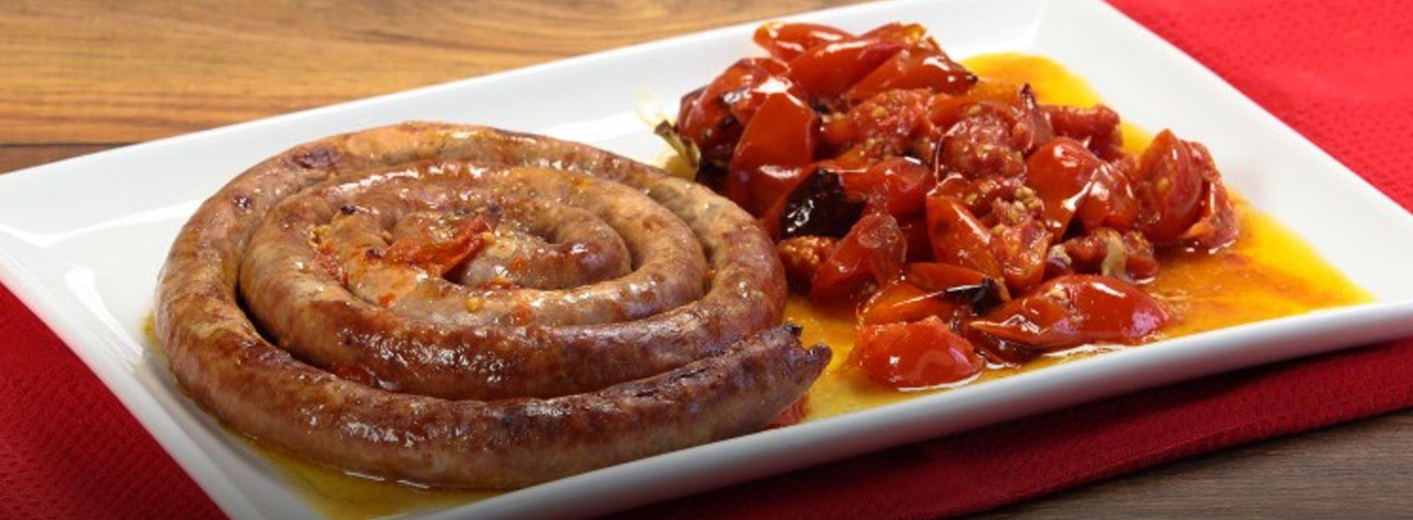 Ricetta: Salsiccia al forno con pomodorini